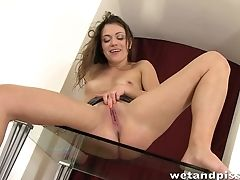 Unexperienced Pissing Honey Is Masturbating Her Cunt On The Table
